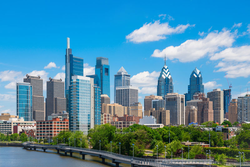A picture of the philadelphia Skyline Taken From Park Drive Blue Sky And Few Clouds